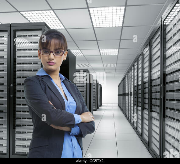 Portrait of a female executive in server room - Stock-Bilder