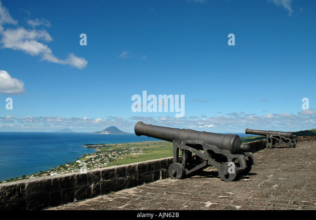 St Kitts Caribbean West Indies Brimstone Hill Fortress Cannon with St Eustatius and Saba in background - Stock Image