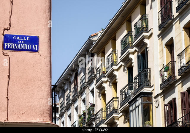 Spain, Europe, Spanish, Hispanic, Madrid, Centro, Chueca, Calle Fernando VI, street sign, residential apartment - Stock Image