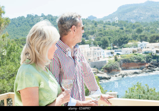 Couple celebrating on holiday, Mallorca, Spain - Stock Image