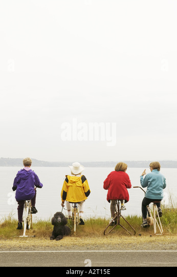 Four women on stationary bikes - Stock Image