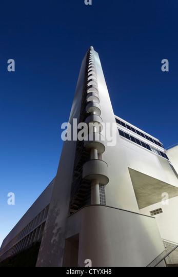 Modern tower on city street - Stock Image