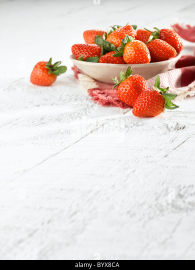 Fresh Strawberries in bowl - Stock Image