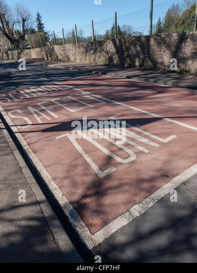School safety zone road markings near primary school in Gloucestershire England UK. - Stock Image