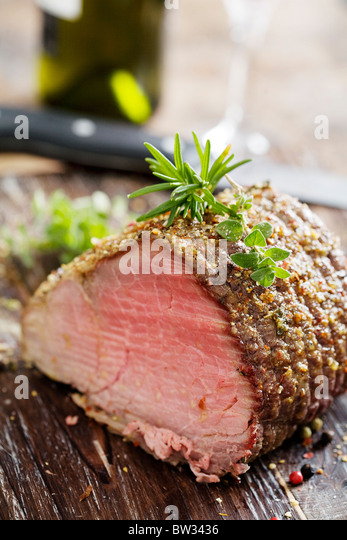 nice piece of roasted sirloin beef covered in herbs - Stock Image