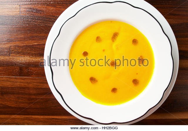 Butter nut squash soup with rep pepper oil emulsion - Stock Image