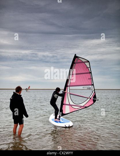 Wind surfing school on one of the beeches on the Island Langeoog. - Stock Image