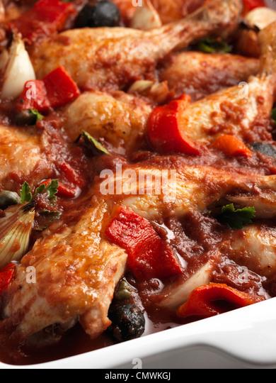 Chicken cacciatore slow cooking Italian casserole - Stock Image