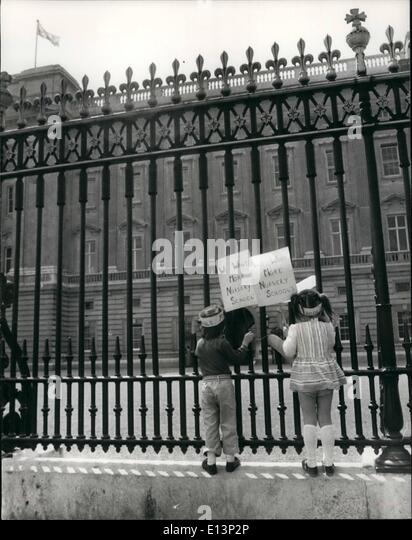 Mar. 22, 2012 - These two youngsters decided to make their protest stronger as they climb the railings at Buckingham - Stock Image