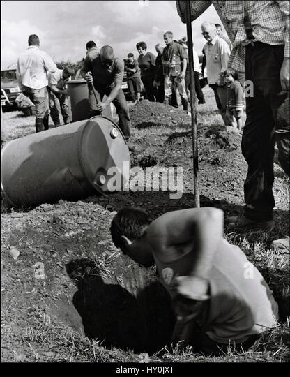 Cornish men dig a hole bury a barrel contest barrel digging contest - Stock Image