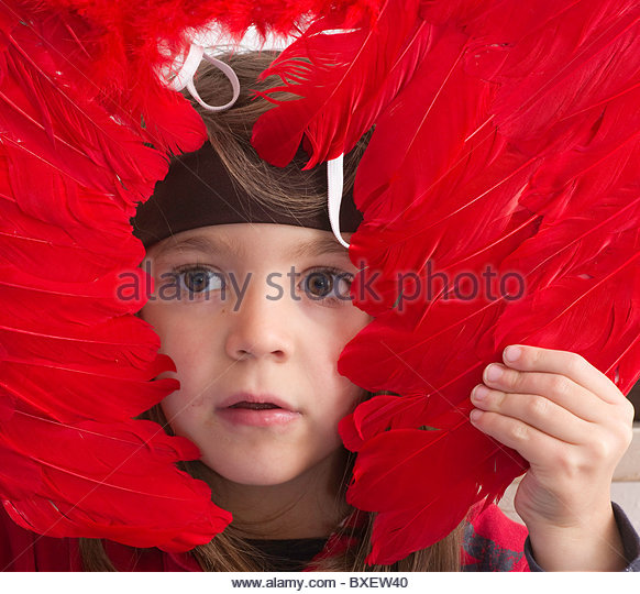 Children child little boy drama class wearing costume mask - red bird feathers party parties face portrait alone - Stock-Bilder