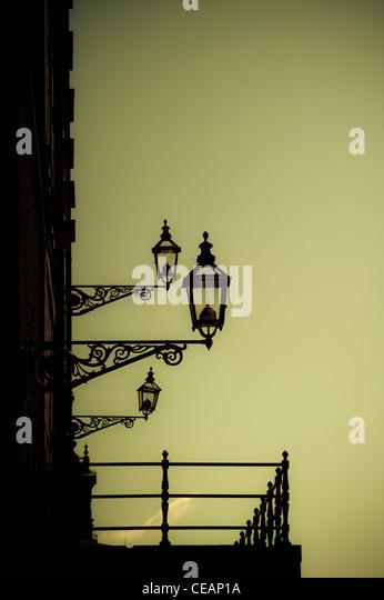 Old-Fashioned Street Lights on building, Stockholm, Sweden - Stock Image