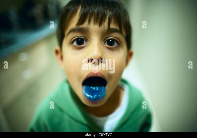 Blue tongue from blue lolly - Stock Image