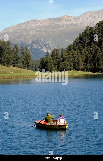 Switzerland couple in boat mountain lake - Stock Image