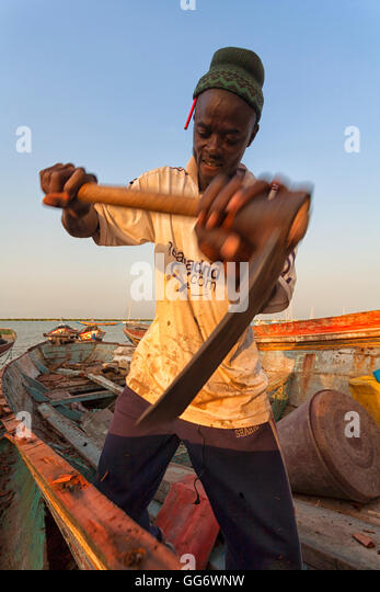 man in Senegal, Casamance area, the Ziguinchor traditional boats building site - Stock Image
