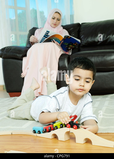 Mother Children Reading Magazine Stock Photos & Mother