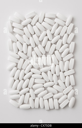 Generic White Lozenge Shaped Pills on a White Background - Stock-Bilder