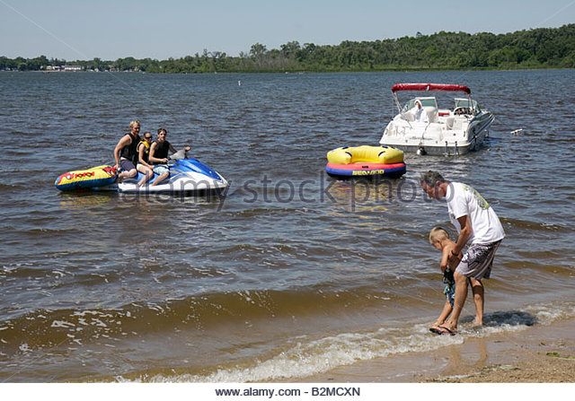 Wisconsin Kenosha Silver Lake Silver Lake Park man men woman boy personal watercraft boat jet ski water sport father - Stock Image