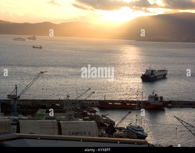 Sunset over The Bay of Gibraltar, Queensway Wharf, Gibraltar, Europe, cloud freight ship shipping tanker boat shipyard - Stock Image