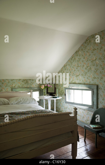 Attic bedroom in 1830s Hudson Valley farmhouse, New York State - Stock Image