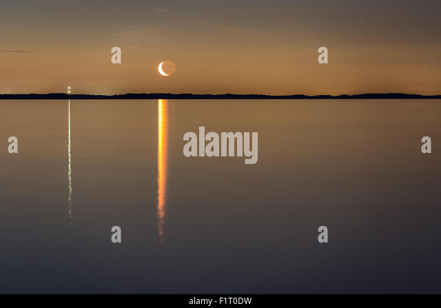 Moon rising seen from Påvskär island, Inkoo, Finland, Europe, EU - Stock Image