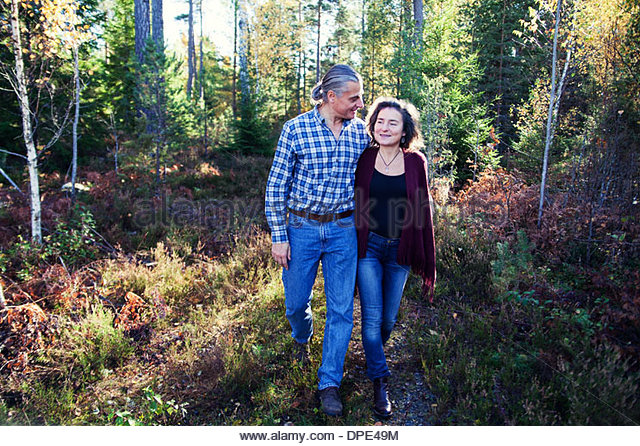 Mature couple strolling in woods, Mariefred, Sweden - Stock Image