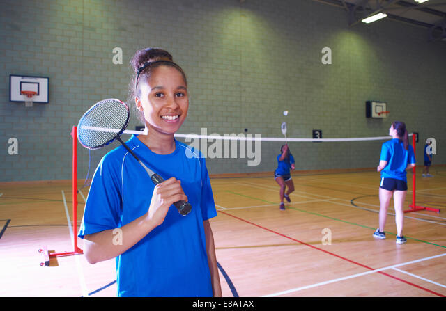 Young woman on badminton court, portrait - Stock Image
