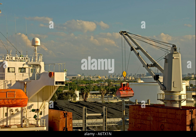 Tampa Bay Florida  Port of Tampa cargo ship at dock unloading open space text space copy space type space - Stock Image