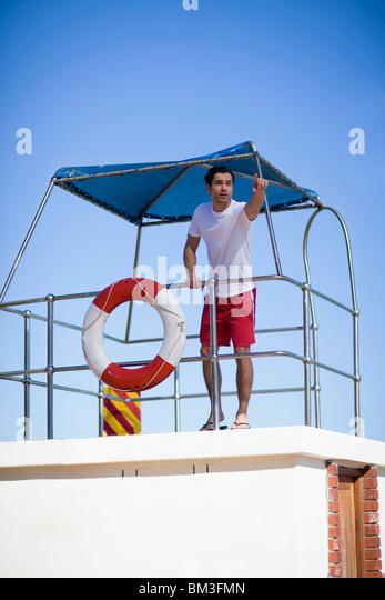 Lifeguard pointing - Stock Image
