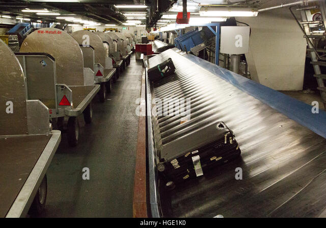 The baggage sorting and handling area at Stuttgart Airport in Stuttgart, Germany. - Stock Image