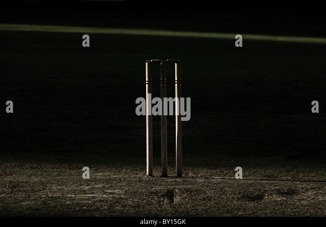 Cricket stumps, dry summer wicket. - Stock Image