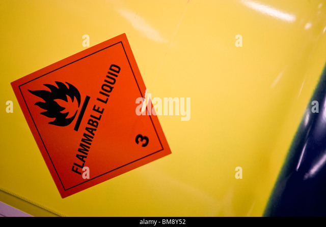 Fabric coating plant, flammable warning label on side of metal drum - Stock Image