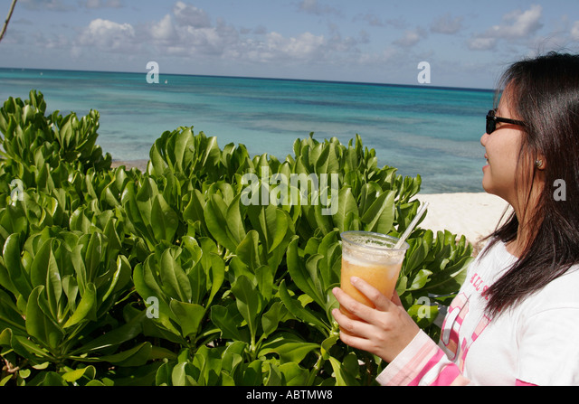 Grand Turk Cockburn Town Duke Street Asian female drink Turks Island Passage - Stock Image