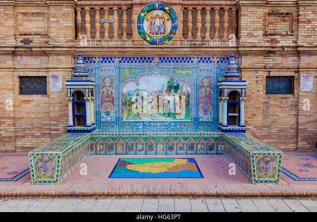 Glazed tiles bench of spanish province of Granada at Plaza de Espana, Seville, Spain - Stock Image