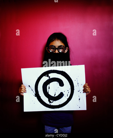 The professor says, 'Hands off: it's Copyright'. Girl with fake beard and glasses holds copyright symbol. - Stock Image