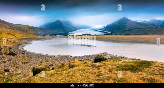 Melting ice from Vatnajokull glacier. Dramatic summer sunset in the Vatnajokull National Park, Iceland, Europe. - Stock Image