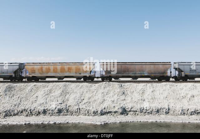 Bonneville Salt Flats Utah USA goods train in the desert on railway tracks - Stock Image