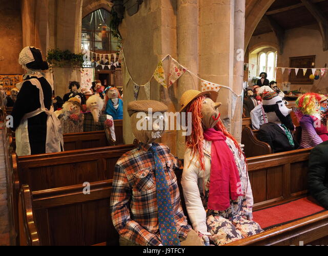 Wedding guests congregation and wedding party at Scarecrow Wedding part of annual scarecrow festival at Orton Cumbria - Stock Image