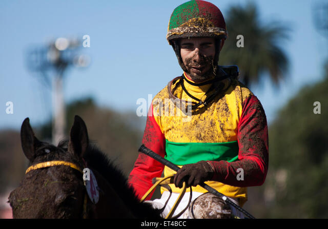 Muddy horseman. Sad look.  Grimace. Loser, dirty, disappointment, colorful, sunny day - Stock Image