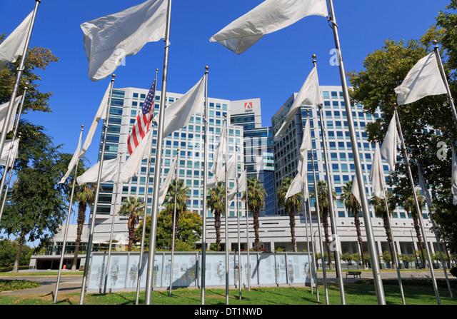 Flags in the Veteran's Memorial and Adobe Corporation, San Jose, California, United States of America, North - Stock-Bilder