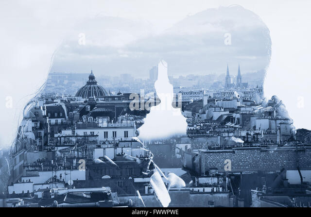 couple in love, man and woman relationships, psychology, double exposure with cityscape - Stock Image