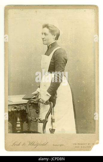 Victorian Cabinet photograph of housekeeper wearing a sewing repair kit circa early 1890's, London, UK - Stock-Bilder
