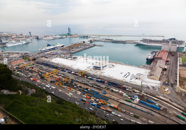 High view of railway sidings and cruise liners dock at Barcelona port. - Stock Image