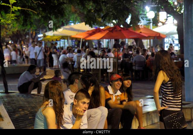 Mendoza Argentina Paseo Sarmiento promenade pedestrian mall shopping dining Hispanic boy girl teen adolescent student - Stock Image