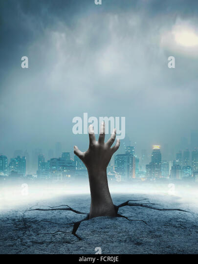 Human hand from the hole - Stock Image