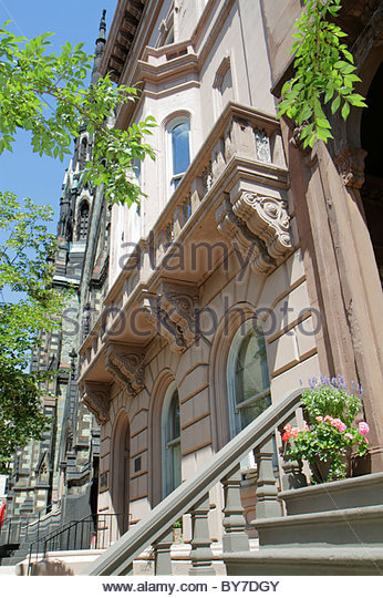 Maryland Baltimore Mount Mt. Vernon Historic District neighborhood stairs flower pot building home balcony - Stock Image