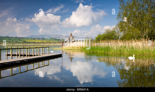 Tranquil morning on Llangorse Lake, with views to the Iron Age Crannog and Pen y Fan beyond, Brecon Beacons National - Stock Image