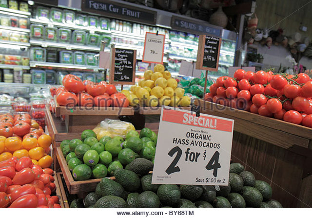 Miami Coconut Grove Florida The Fresh Market grocery store produce avocados - Stock Image