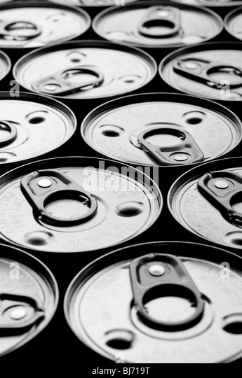 a vertical shallow focus array of tin cans - Stock Image