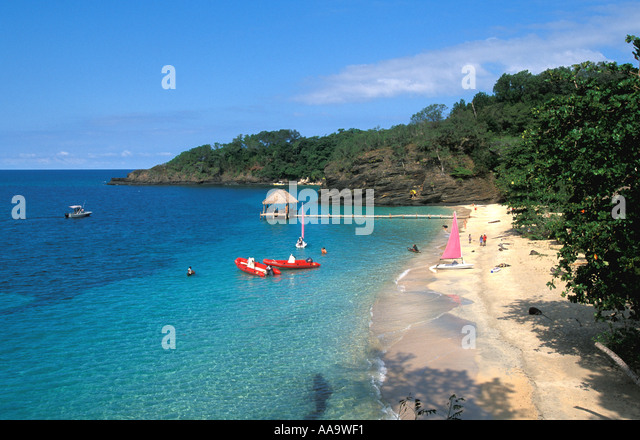 Honduras Bay Islands Beach sailboats at Cochino Pequeno - Stock Image